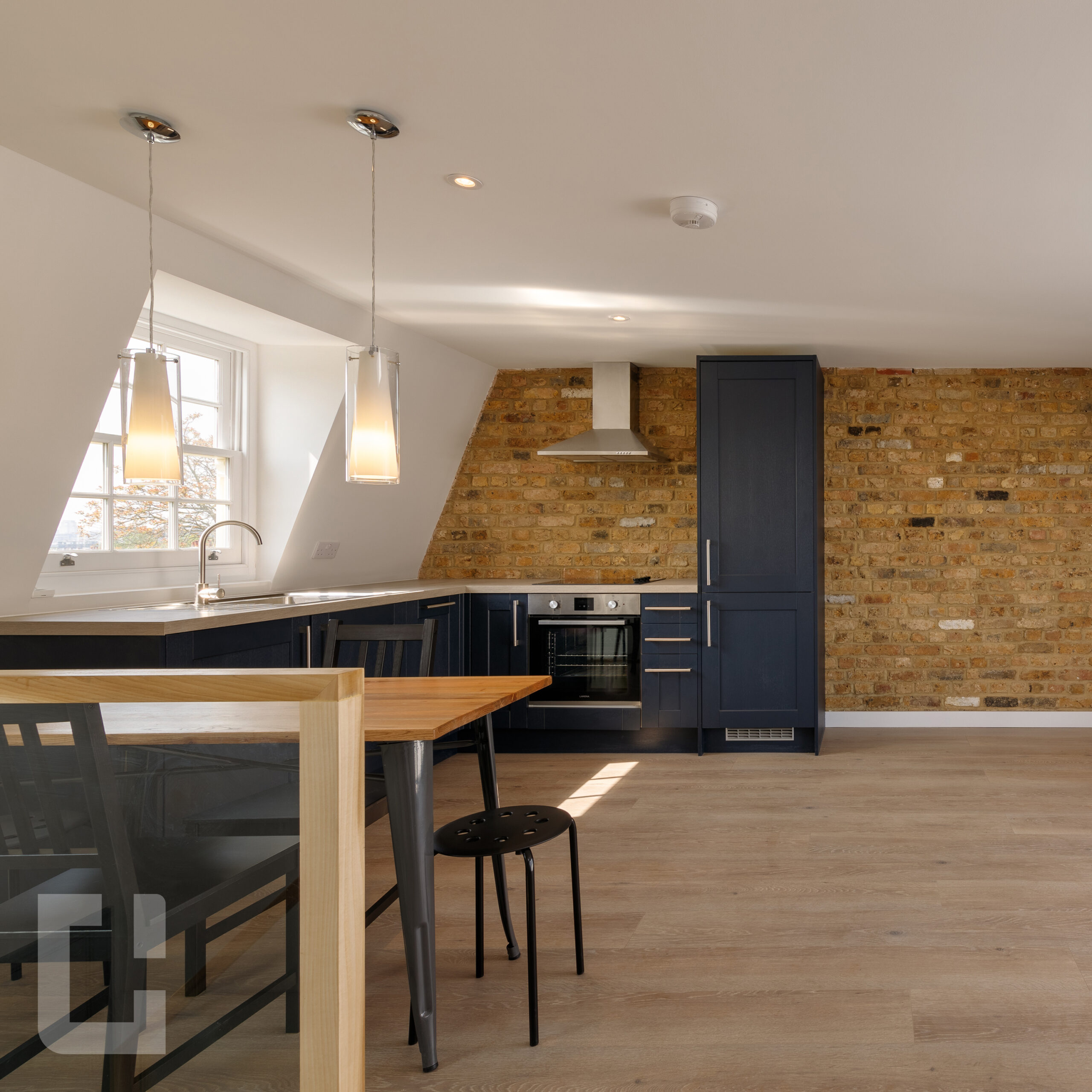 Loft Conversion Studio With Brick Wall